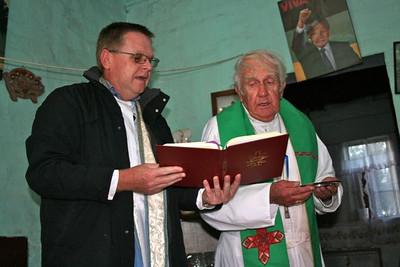 "Fr. Peter Surdel and Bishop Joe Potocnak celebrate a home Mass in the ""black location"" of Middelburg."