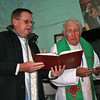 "Fr. Peter Surdel and Bishop Joe Potocnak celebrate a home Mass in the ""black location"" of Middelburg."