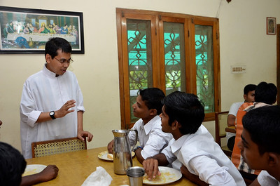 Fr. Heru with students at Dehon Bhavan in Kumbalanghy