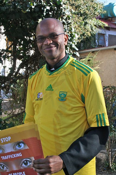 Fr. Ntsikelelo Bambatha shows off his World Cup spirit with a South African team jersey.  Bafana Bafana!!!