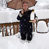 Snomageddon - 6 February 2010<br /> Mom's a good sport about providing perspective on the depth of the snow on the back deck.<br /> (The white boots she's wearing are knee-length.)