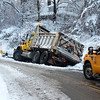 A snow plow went off Harmonyville Road in South Coventry and into a ditch Monday, Feb. 3, 2014. Photo by Steve Weil