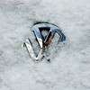 The VW emblem on my car.  If you look carefully, you can see me with my camera in the reflection
