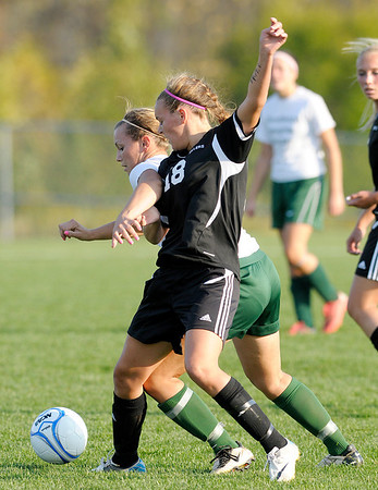 Pendleton Heights' Sydney McCullum and Noblesville's Julia Birkhimer fight for control of the ball as the Arabians faced the Millers in sectional action at the White River Soccer Fields in Noblesville on Thursday.