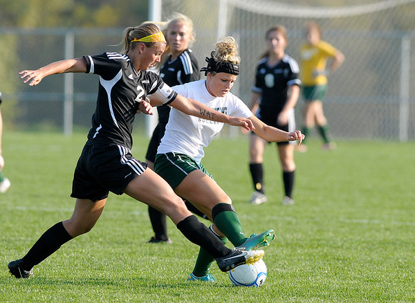 Noblesville's Hannah Mangus and Pendleton HeightsJamie McCrocklin fight for control of the ball as the Arabians faced the Millers in sectional action at the White River Soccer Fields in Noblesville on Thursday.