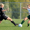 Noblesville's Grace Myers tries to take the ball from Pendleton Heights' Kayleigh Corn as the Arabians faced the Millers in sectional action at the White River Soccer Fields in Noblesville on Thursday.