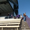 Diehard softball fans watching from Husky Stadium