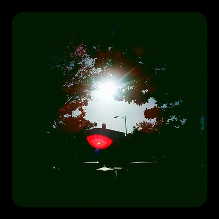 If you look closely in the red lens flare, you'll see a little projection (reflection?) of the eclipse in progress.
