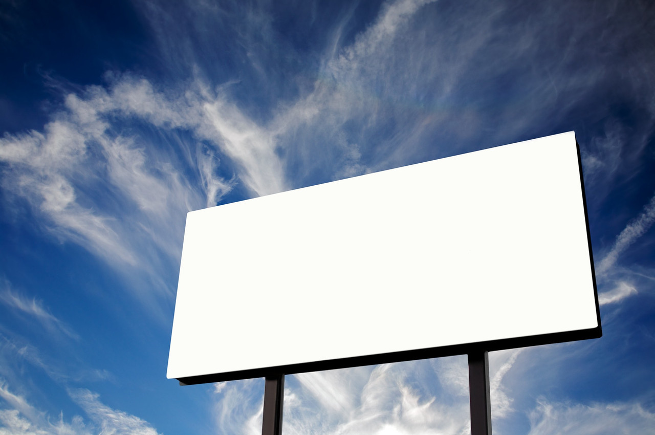 Brand new billboard and a wispy blue sky - I made this out of a baseball scoreboard to sell on stock photo sites