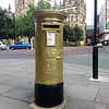 A photo of Manchester's Golden Postbox.