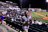 Jessica Doyle, marketing and promotions representative for the Jackson (TN) Generals AAA baseball team, tosses free ice cream bars to the crowd