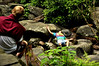 Hikers take a break on the Grotto Falls trail at the Great Smokey Mountains National Park near Gatlinburg, TN