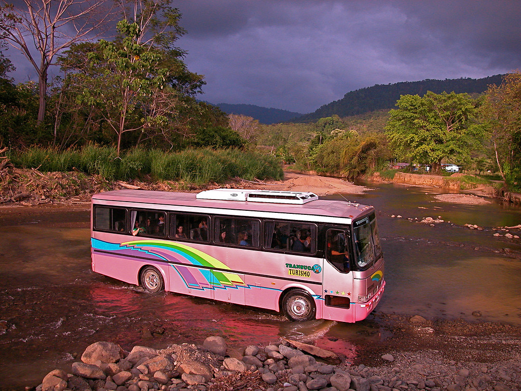 Crossing a small river in the early dry season near the Pacific coast of southern Costa Rica.  This road is being paved and bridges added, which is leading to rapid development of what used to be an undeveloped paradise.