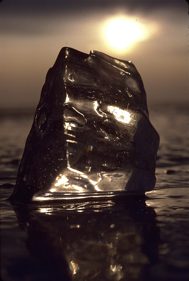Chunk of ice frozen on Lake Champlain, with rising sun in the background.  You don't want to know how cold it was that morning, especially laying on the ice to get this shot.