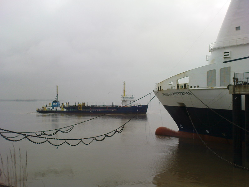 "The inshore tanker passing the bows of the ""Pride of Rotterdam"" RORO ferry"