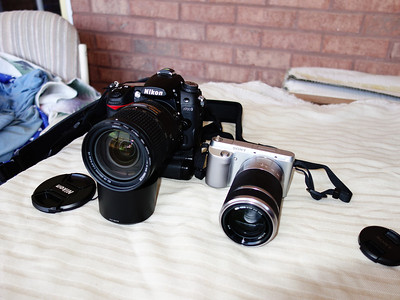 The Nikon D7000 with the Nikon 18-300mm lens and the Sony Nex F3 with the Sony 55-200mm lens.