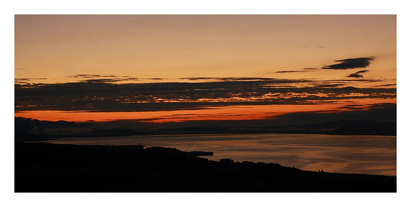 Levé du jour sur le lac de Neuchâtel