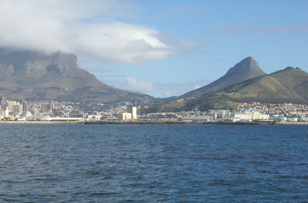 Table Mountain (left), Lion's Head (middle), and Signal Hill (right). Taken from the ferry to Robben Island.
