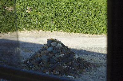 "The story behind this pile of rocks: During 1995 visit, Nelson Mandela placed a few small rocks on the ground at the entrance to the quarry where he worked during his twenty-seven year captivity. Each of the other former political prisoners visiting on that day followed his lead, adding a stone to the growing pile. Robben Islander Mogaman Levy recounts that Mandela, upon placing the first few stones together, told the other former prisoners, ""This is how easily a monument can be built"""