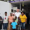 Dan Leader stands outside the bakery with some of the bakers, moms and kids.  Just behind Dan you can see the back of the oven and to the right of the lady in the yellow shirt is the sales desk!