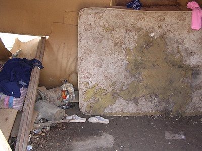 This is a matress I had burned because the children in the shack were covered in scabs from mites that nested in bed as they slept. Don't worry I got them a new bed 4 inched off the floor.