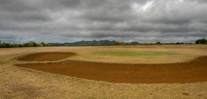 Fourth green and sand traps, golf course on St. Helena island, South Atlantic Ocean.