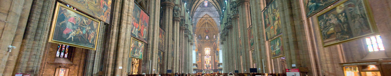 Stitch of interior of the Duomo during Sunday mass, Milan, Italy.