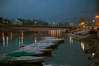 Boats along the shore at Lecco, Italy.