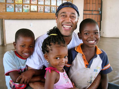 craig, on his first trip to south africa, with cibu, ndumi and another random cute kid