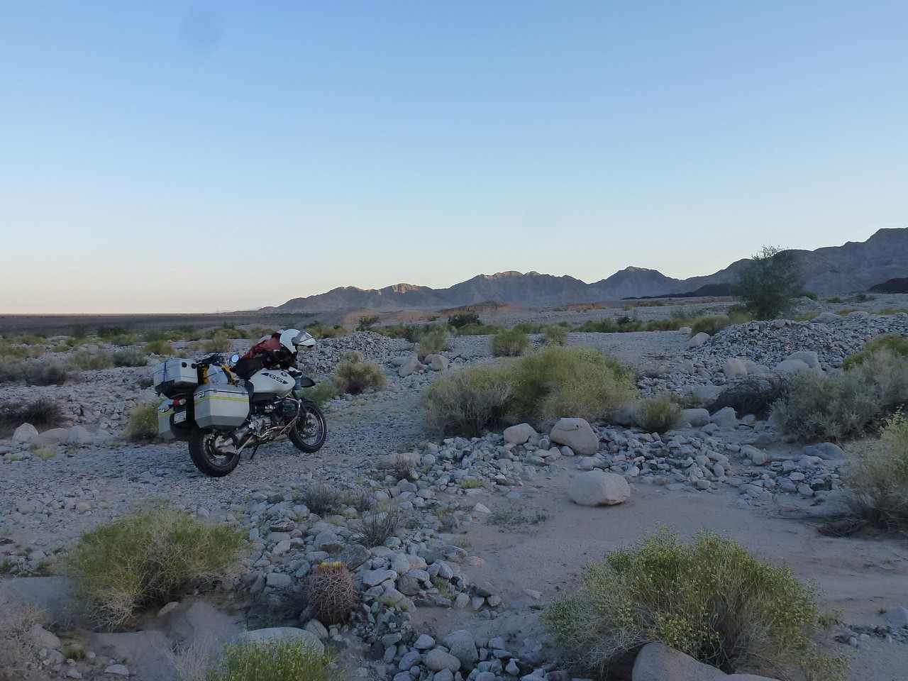 Sierra Mayor Mtns , Baja California <br /> <br /> Pitched my tent , right in that smooth spot , to the right of my bike .<br /> <br /> Off to the left of my bike , about ten miles or so , is the Colorado River ,heading for the Sea of Cortez .