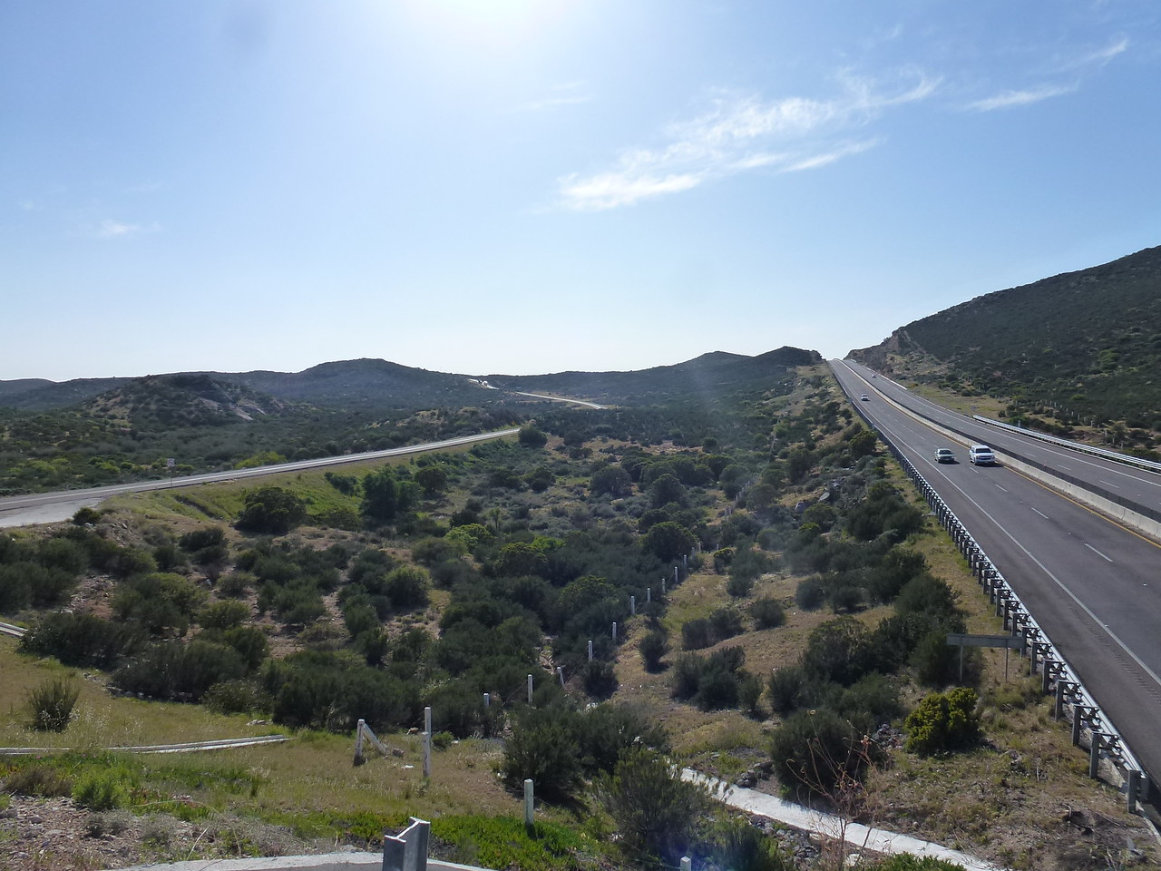Heading East from Tecate , Mexico , there are 2 roads - <br /> <br /> a two lane free road ( libre ) and the new 4 lane toll road ( cuota ) <br /> <br /> I rode up on a over pass for this photo
