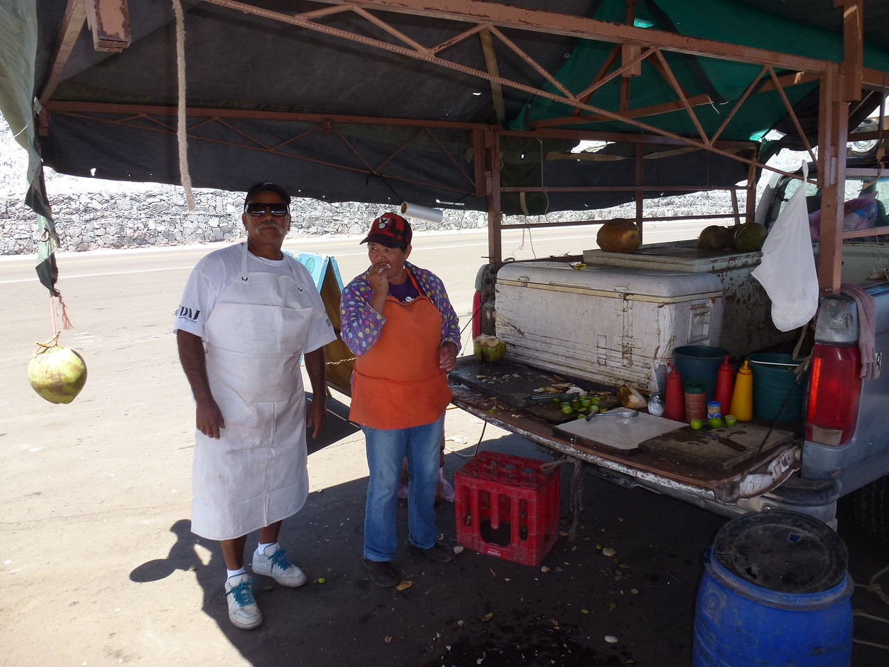 I headed South , when my pals left .  Got down the road 50 miles or so and this couple was selling coconuts out of their truck<br /> <br /> Don't look too closely at the chopping board !<br /> <br /> <br /> She really did not want her photo taken -she never said a word and he never even tried one word of English ! <br /> <br /> But the coco was delish and very refreshing .  50 pesos ...about $3 US