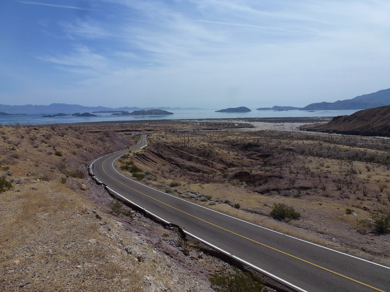 Bahia de Los Angeles <br /> <br /> Look to the right , down in the coulee and you can see the overland flow of rocks , sand and gravel  , from hurricane Odile , last fall <br /> <br /> Odile , was a class 4 hurricane.      <br /> <br />  Really hurt a lot of Mexican families .