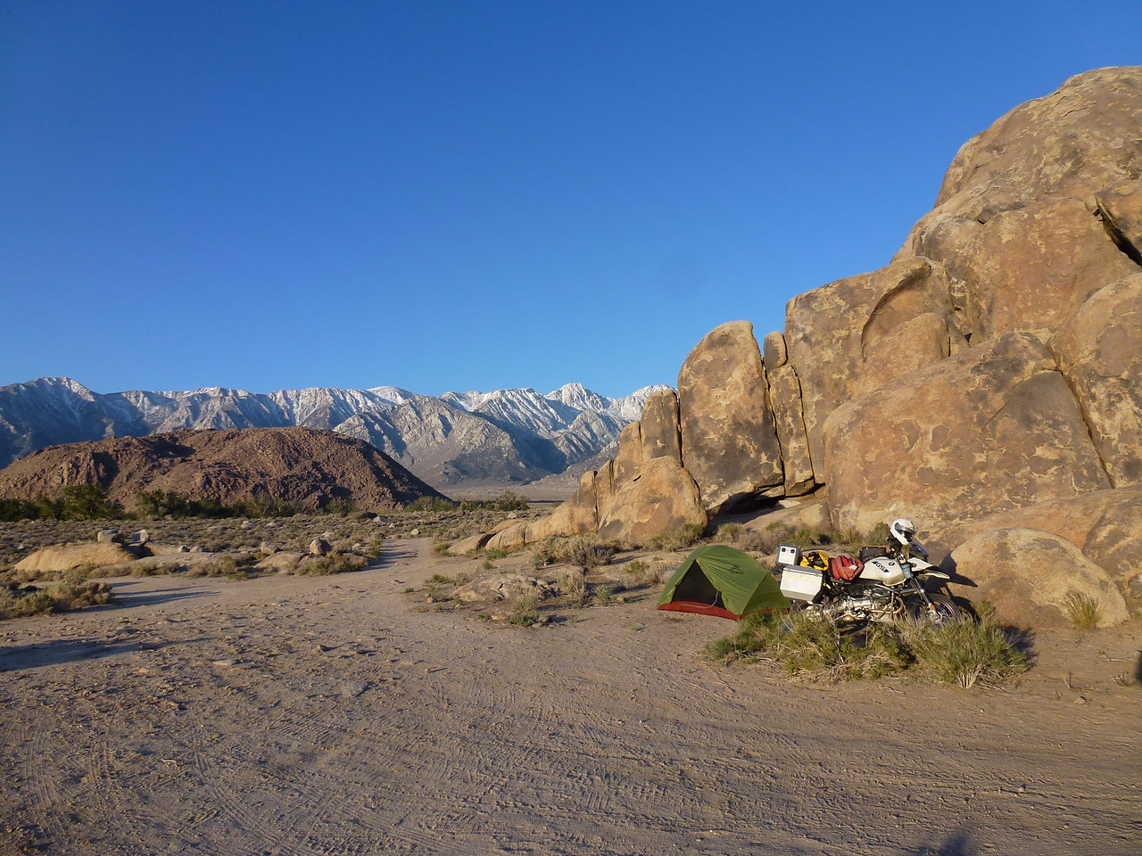 Alabama Hills , Ca. <br /> <br /> This is at 6:30 am after a very miserable night in my little green tent . <br /> <br />  I had it tied down 5 different ways and still thought the wind was going to carry me away .<br /> <br /> They filmed many old western films in these rocks -hundreds and hundreds of acres of rocks , like these behind my tent .