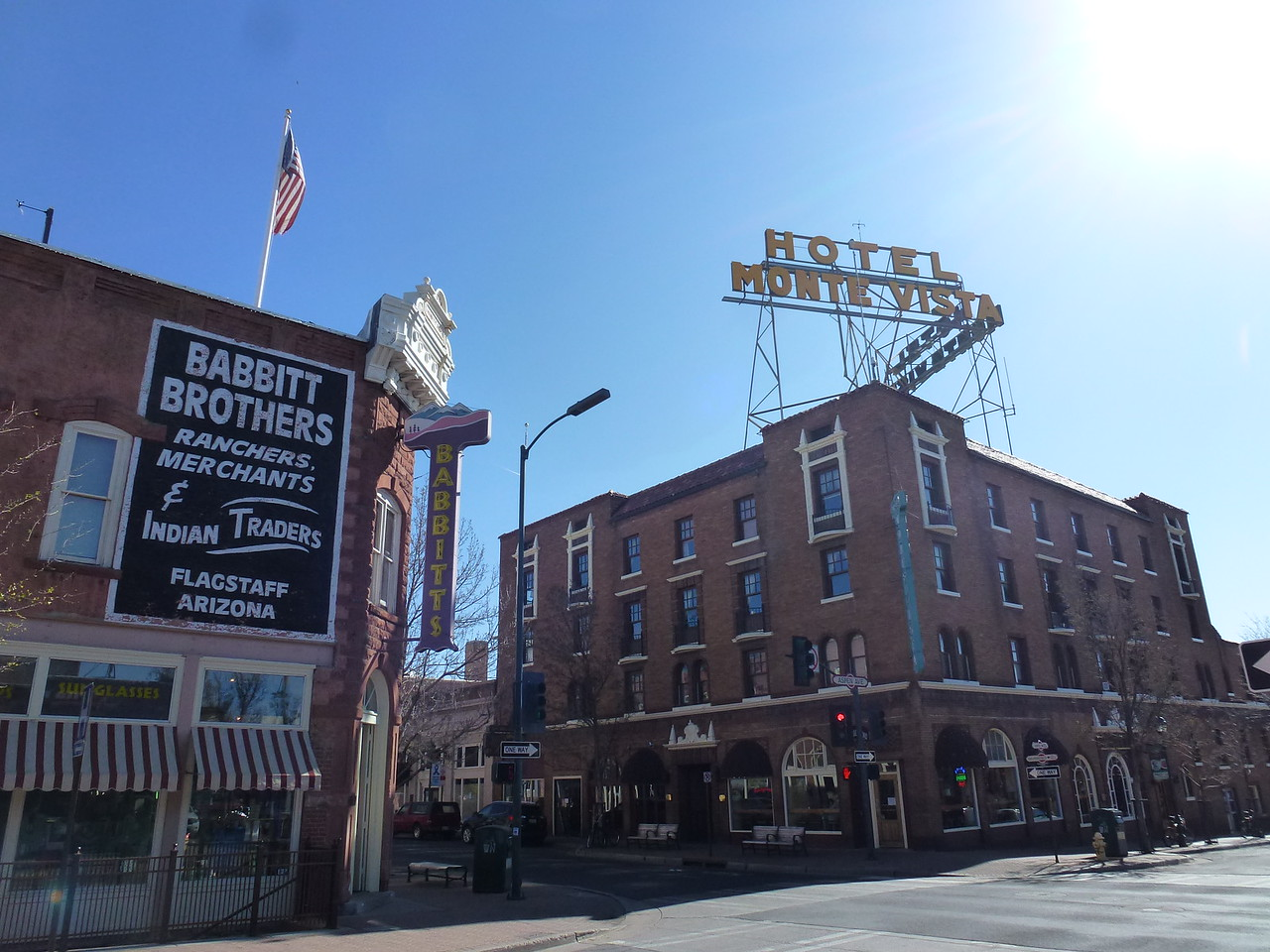 """Historic part of Flagstaff <br /> <br /> Its my understanding that they put these signs way up high , so that travelers would have seen them from RT 66 , back in the day . <br /> <br /> Route 66 , """"The Mother Road """" as its called , is main street in Flag"""