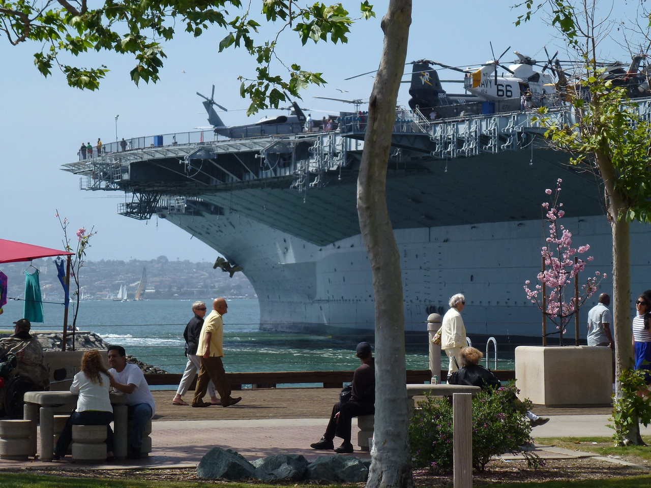 "Easter Sunday at San Diego , California    <br /> <br />    Famous carrier -  USS Midway-  in the background .<br /> <br /> I almost chickened out on riding in to this big city .....was filling my bike with gas and talking with a fella there . <br /> <br /> He said "" if there ever was a day for you to ride downtown San Diego , This is the day !"" <br /> <br /> He meant that because it was Easter , traffic would be light"
