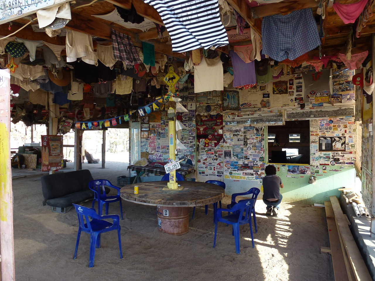 Coco's Corner , Baja California <br /> <br /> You just have to stop here and have a beer at Coco's !<br /> <br /> 78 year old diabetic man , that has carved out a living here . In the past few years , he has lost both legs to the disease .<br /> <br /> Doesn't stop him from having cold beer and a huge collection of womens underwear !
