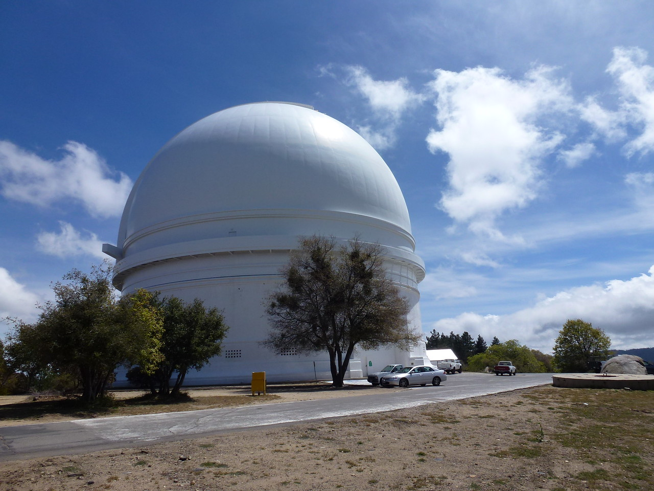 MT. Palomar , California <br /> <br /> This is one of 3 telescopes up here .  This is the Hale 200 inch telescope -in other words the mirror is 200 inches wide , and it was written inside , that the telescope itself, weighs 500 tons .<br /> <br /> Before Hubble came along , this was one of the worlds most famous telescopes.