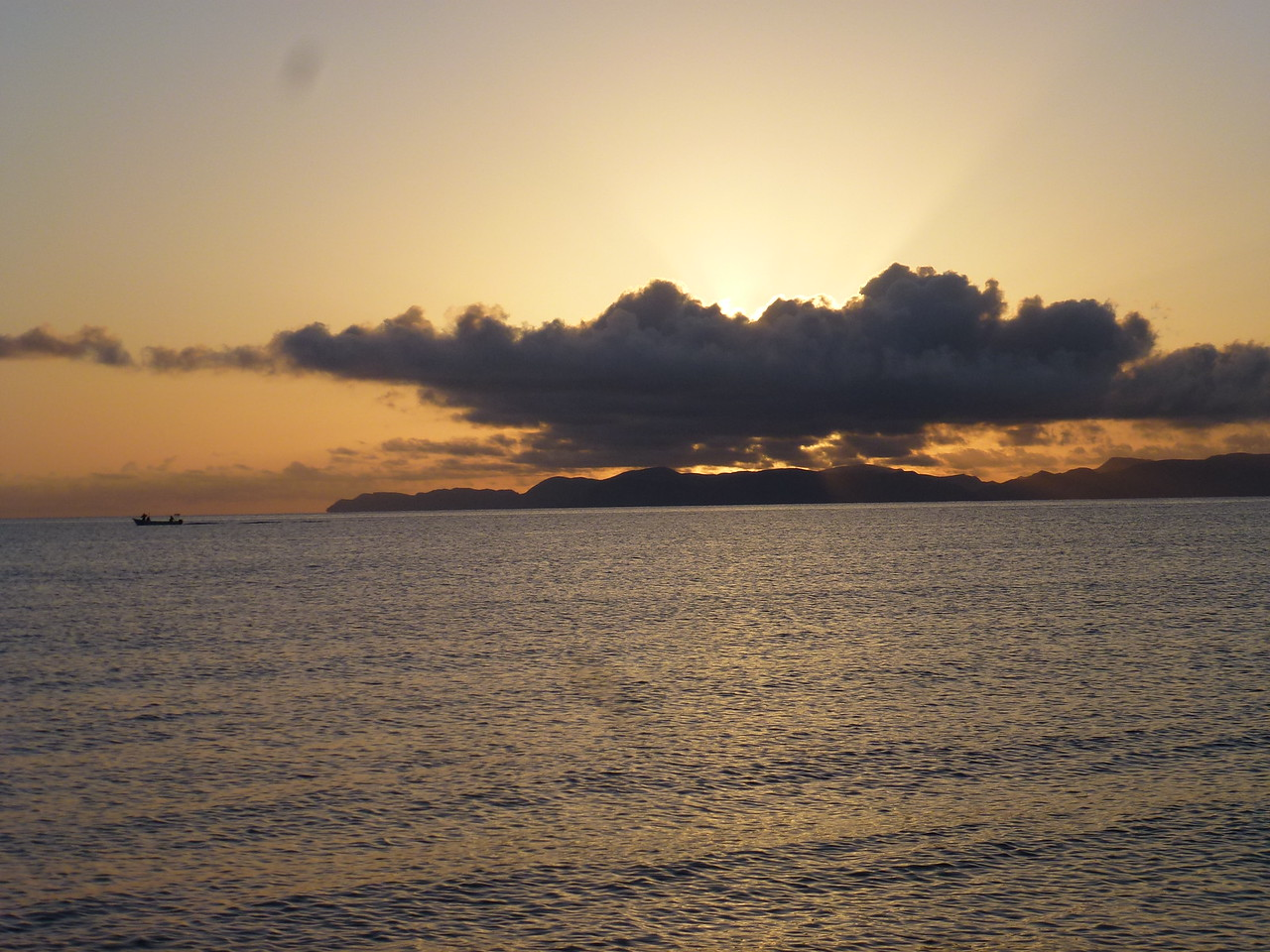 Every morning , the sunrise was different <br /> <br /> See the fishing boat (panga ) headed out