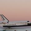 Endeavour sits atop its ride at Ellington Field.