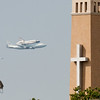 Endeavour passes behind the Christus St. John Hospital Tower.
