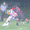 Corey J. Corbin/NEWS<br /> Wilmington quarterback Cody Llewellyn is sacked by Hickory's Tyler Reardon last night.