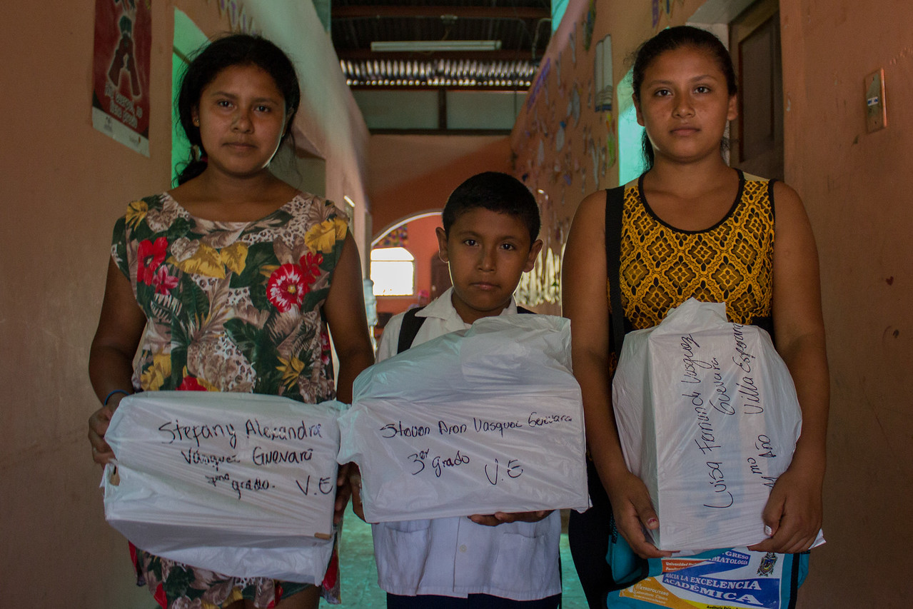 Steven and his sister receiving uniforms and shoes for school.
