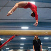 OLD TOWN, Maine -- 03/18/2017 --  A gymnasts leaps through the air as part of her beam routine during the 2017 Level 6-10 gymnastics state championship at the Old Town-Orono YMCA in Old Town Saturday. Ashley L. Conti | BDN