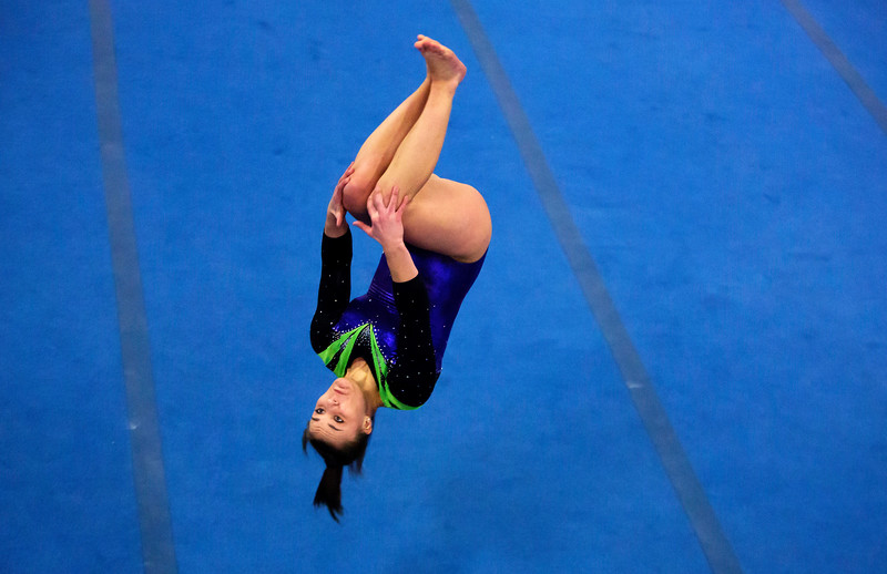 OLD TOWN, Maine -- 03/18/2017 -- Caitlyn Rollins tumbles through the air as part of her floor routine during the 2017 Level 6-10 gymnastics state championship at the Old Town-Orono YMCA in Old Town Saturday. Ashley L. Conti   BDN