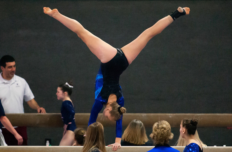 OLD TOWN, Maine -- 03/18/2017 --  A gymnasts competes on the balance beam during the 2017 Level 6-10 gymnastics state championship at the Old Town-Orono YMCA in Old Town Saturday. Ashley L. Conti | BDN