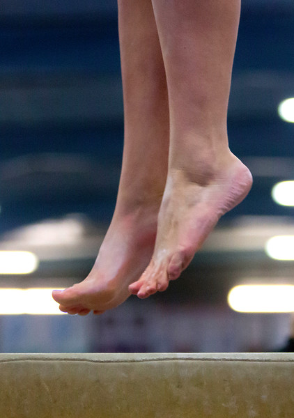 OLD TOWN, Maine -- 03/18/2017 -- A gymnasts performs on the balance beam during the 2017 Level 6-10 gymnastics state championship at the Old Town-Orono YMCA in Old Town Saturday. Ashley L. Conti | BDN