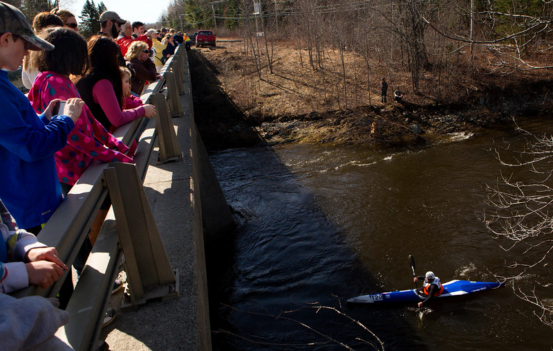 KENDUSKEAG, Maine -- 04/15/2017 -- People line a bridge to watch racers during the 51st annual Kenduskeag Stream Canoe Race Saturday. The 16-mile race starts in Kenduskeag and ends in downtown Bangor.  Ashley L. Conti | BDN