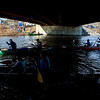 KENDUSKEAG, Maine -- 04/15/2017 -- Racers head off under the start bridge during the 51st annual Kenduskeag Stream Canoe Race Saturday. The 16-mile race starts in Kenduskeag and ends in downtown Bangor.  Ashley L. Conti | BDN