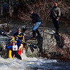 BANGOR, Maine -- 04/15/2017 -- Stephen Comeau and Jake Gutkes get their kayak stuck on a rock while trying to navigate Six Miles Falls during the 51st annual Kenduskeag Stream Canoe Race Saturday. The 16-mile race starts in Kenduskeag and ends in downtown Bangor.  Ashley L. Conti | BDN